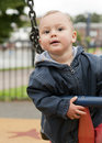 Toddler on swing Royalty Free Stock Images