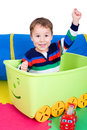 Toddler in a toybox little boy is sitting Stock Photo