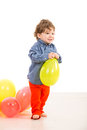 Toddler walking with balloon boy and holding against white background Stock Images