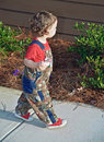 Toddler Walking Outdoors Royalty Free Stock Photos