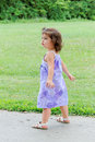 Toddler walking in park Royalty Free Stock Image