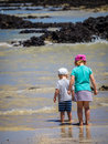 Toddlers on the beach Royalty Free Stock Photo
