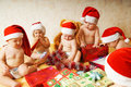 Toddlers in Christmas hats Royalty Free Stock Images