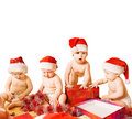 Toddlers in Christmas hats Stock Photography
