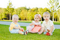 Toddlers on grass Royalty Free Stock Image