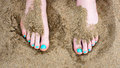 Toes against sand at the beach Royalty Free Stock Photo