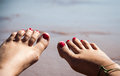 Toes and ocean in front of the beach Royalty Free Stock Photo