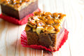 Toffee cake on red paper Royalty Free Stock Photo