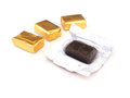 Toffee and gold wrapper packaging on white background Stock Photography