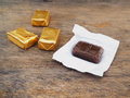 Toffee and gold wrapper packaging on white background Royalty Free Stock Photos