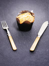 Toffee muffin closeup of a on a slate background with copy space Royalty Free Stock Images