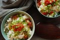 Tofu and mentaiko donburi bowl of rice with spicy seasoned alaska pollock roe chopped green onions on top Stock Photos