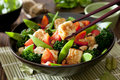 Tofu vegetable stir fry closeup of a bowl of and Stock Images