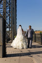 Together for life the bride and groom go over the bridge on your wedding day Royalty Free Stock Photos