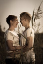 Together lovely lesbian couple on outdoor sepia black and white image Royalty Free Stock Photo