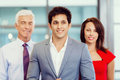 Together we will win group of businesspeople in office standing Stock Photo