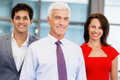 Together we will win group of businesspeople in office standing Royalty Free Stock Photo