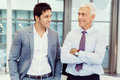Together we will win two businessmen in office standing Royalty Free Stock Photography