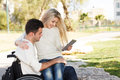 We together young disabled men and his girlfriend with digital tablet Royalty Free Stock Image