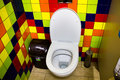 Toilet cubicle in cafe with colorful tiles on the walls Royalty Free Stock Image