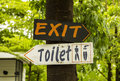 Toilet and exit signs to the Stock Images