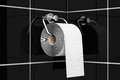 Toilet paper on chrome holder a black tiles background Stock Image
