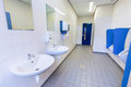 Toilet room for men with urinals sinks and mirrors Royalty Free Stock Photo