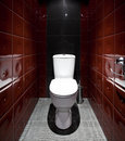 Toilet room in red colors Royalty Free Stock Photo