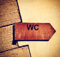 Toilet sign wooden pointer in vintage style Stock Photography