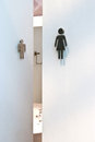 Toilet signs on white doors metal wooden Stock Photography