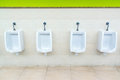 Toilet urinal white man toilets tiles on floor and walls Royalty Free Stock Photography