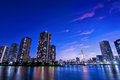 Tokyo bay skyline skyscrapers reflect in in the early evening Stock Image
