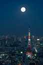 Tokyo cityscape the of at night beneath a full moon Royalty Free Stock Images