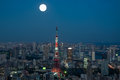 Tokyo cityscape the of at night beneath a full moon Stock Image