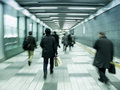 Tokyo commuters in an underground tunnel motion blur Royalty Free Stock Photos