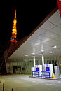 Tokyo hydrogen fueling station with tower illuminations in the background Stock Images