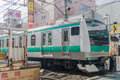 Tokyo, Japan - January 26, 2016: JR Commuter japanese local train in Tokyo , Japan Royalty Free Stock Photo