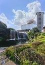 Azalea shrubs surrounding the big waterfall and pond of Hotel New Otani. Royalty Free Stock Photo