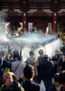 Tokyo japan nov buddhists gather around a fire to light i incense and pray at sensoji temple on november in Stock Photo