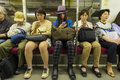 Tokyo metro commuters in checking mobile phones Stock Image