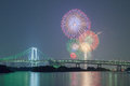 Tokyo rainbow bridge with beautiful firework Royalty Free Stock Photo