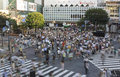 Tokyo shibuya crossing famous crossroad in japan aerial view at sunset pedestrians in motion Stock Photos