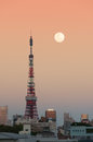Tokyo tower at dusk with the moon rising Stock Photo