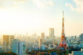 Tokyo tower, landmark of Japan, and panoramic modern city bird eye view with dramatic sunrise and morning sky Royalty Free Stock Photo