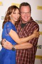 Tom arnold illeana douglas Photo stock