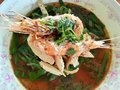 Tom yam goong noodle thai food thailand traditional fusion cuisine in the bowl has a shrimp and vegetables Stock Photo