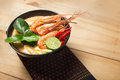 Tom Yum Goong thai food cuisine on wooden Royalty Free Stock Photo
