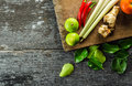 Tom yum recipe cooking of thai dish it consist of chillies galangal ginger lemongrass stalks kaffir lime leaves tomato and limes Stock Images