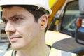 Tomadas de wearing protective ear do trabalhador da construção Imagem de Stock Royalty Free