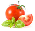 Tomato with basil Royalty Free Stock Photo